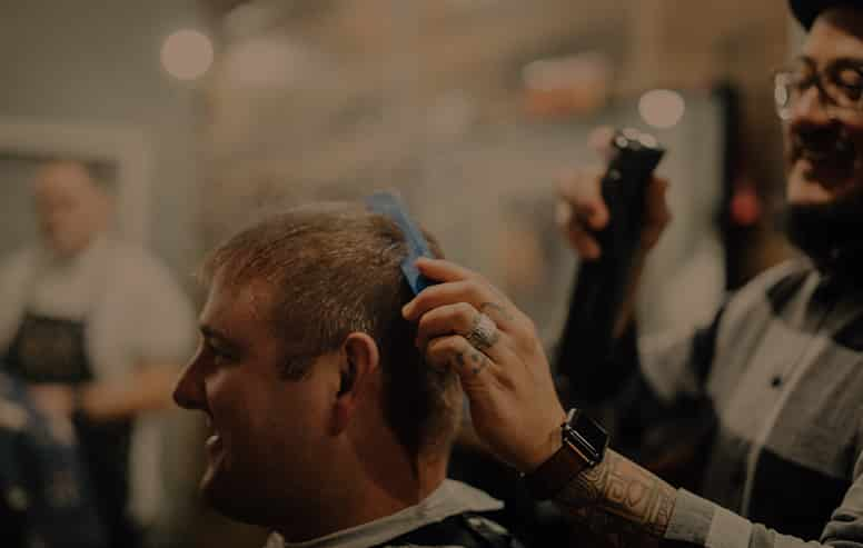 Image of Barber styling a customers' hair