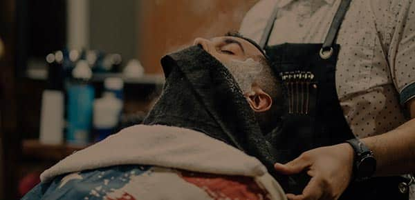 image of steam towel over a gentleman's face